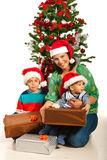 Happy mother with boys at Christmas Stock Photo