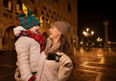 Happy mother with camera and child on Piazza San Marco in Venice Stock Photo