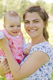 Happy mother with child. Happy mother with her baby girl royalty free stock photo