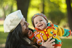 Happy mother with child. Joyful mother playing with her child in the park Stock Image