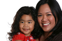 Happy mother and child. Cute girl and attractive young woman smiling royalty free stock images
