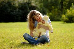Happy mother and child. On green grass Royalty Free Stock Images