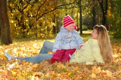 Happy mother with child in autumn park Stock Photo