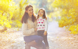 Happy mother and child in autumn Royalty Free Stock Photo