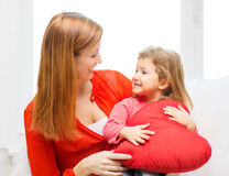 Happy mother and child with big red heart at home. Children, parenthood and happiness concept - happy mother and child with big red heart at home Royalty Free Stock Photos