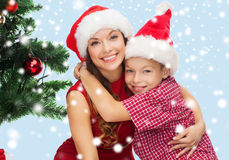 Happy mother and child boy in santa helper hats Royalty Free Stock Photos