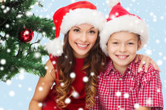 Happy mother and child boy in santa helper hats Stock Photo