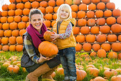 Happy mother and child choosing pumpkins Royalty Free Stock Photo