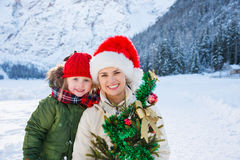 Happy mother and child with Christmas tree in front of mountains Stock Photography