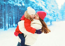 Happy mother and child daughter having fun together in winter Royalty Free Stock Images