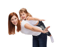Happy mother and child doing piggy back. Childhood and parenting concept - happy mother and child doing piggy back Stock Photo