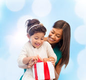Happy mother and child girl with gift box Stock Image