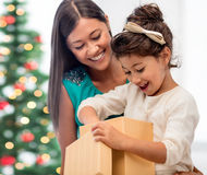 Happy mother and child girl with gift box Stock Images