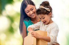 Happy mother and child girl with gift box Stock Photo