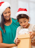 Happy mother and child girl with gift box Royalty Free Stock Photos