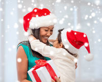 Happy mother and child girl with gift box Royalty Free Stock Image