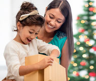 Happy mother and child girl with gift box Royalty Free Stock Images