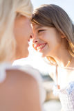 Happy mother and child girl outdoors Royalty Free Stock Photos