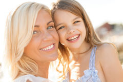 Happy mother and child girl outdoors Stock Photo