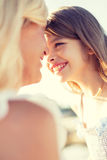 Happy mother and child girl outdoors Royalty Free Stock Photo