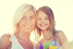 Happy mother and child girl with pinwheel toy Stock Images