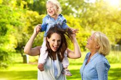 Happy mother with child and grandmother Royalty Free Stock Photos