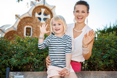 Happy mother and child handwaving in Park Guell, Barcelona Stock Images