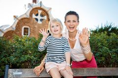 Happy mother and child handwaving in Park Guell, Barcelona Royalty Free Stock Images