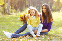 Happy mother with child having fun in autumn park Stock Photography