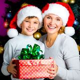 Happy mother with child hold box with gift on the christmas Royalty Free Stock Photos