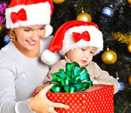 Happy mother with child hold box with gift on the christmas Stock Images
