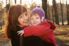 Happy mother and child hugging in nature Stock Photography