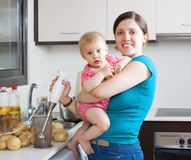 Happy mother with child  in kitchen Royalty Free Stock Photo