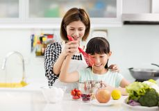 mother and child in kitchen preparing cookies Stock Photo