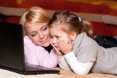 Happy mother and child with laptop computer Stock Photos