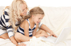 Happy mother and child with laptop computer Stock Photography