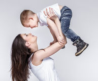 Happy mother with a child on light grey background Stock Photography