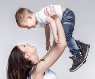 Happy mother with a child on light grey background Stock Photo