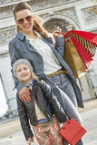 Happy mother and child near Arc de Triomphe in Paris, France Stock Photos