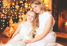 Happy mother and child near christmas tree with fireplace Stock Images