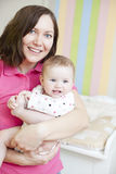 Happy mother and child in nursery Royalty Free Stock Image