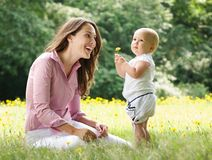 Happy mother and child in the park Royalty Free Stock Images