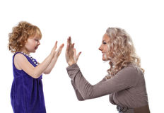 Happy mother and child play together isolated Stock Images