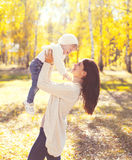 Happy mother and child playing having fun in autumn Stock Photos