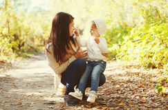 Happy mother and child playing together in autumn Royalty Free Stock Image