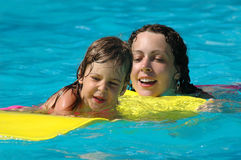 Happy mother and child in pool Royalty Free Stock Image