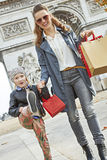Happy mother and child shopper near Arc de Triomphe going forwar Royalty Free Stock Photo