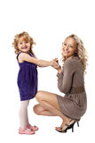 Happy mother and child smile isolated. Happy mom and her daughter take hands smile isolated Stock Photos
