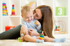 Happy mother and child son playing  indoor at home Stock Image