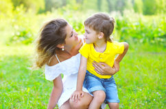 Happy mother with child son together outdoors in summer Royalty Free Stock Photos